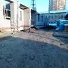 10.02.2015. Жилой дом по ул. Гоголя, 72. Первый этаж. На фоне здание военного городка